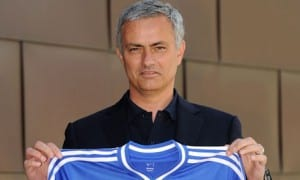 New Chelsea manager Jose Mourinho holds up the club shirt